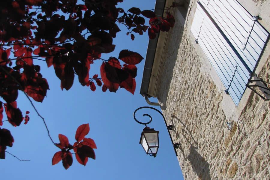Burgundy stone home shutters
