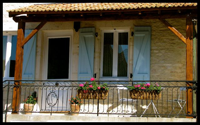 Balcony of Home in Burgundy with Blue Shutters and Flowers - France