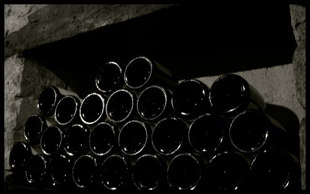 Wine Bottles Stacked in Winery Cellar - Burgundy, France