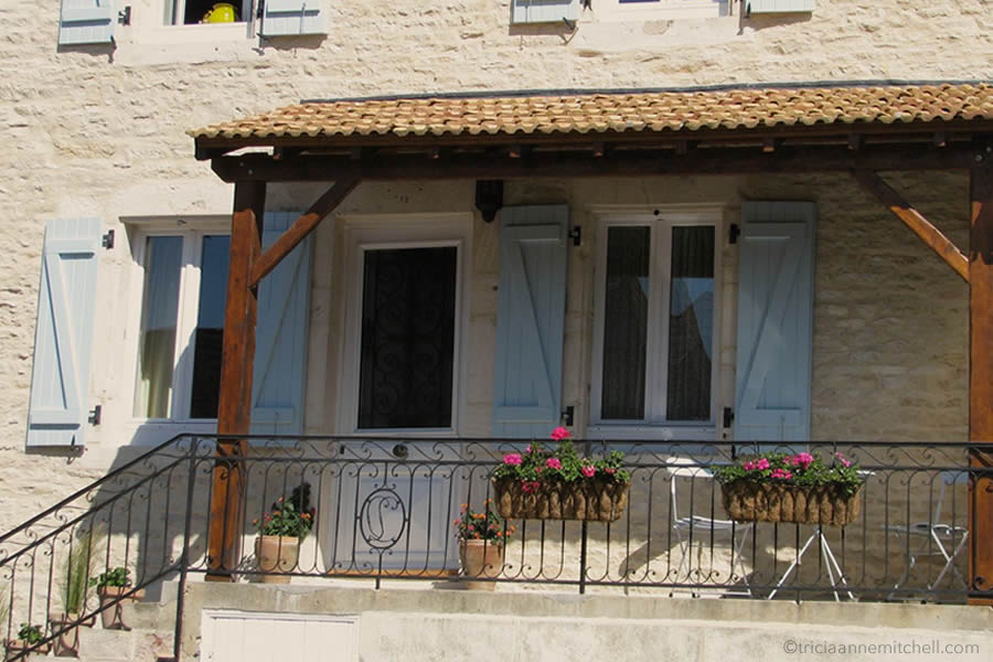 refurbished stone home Burgundy France shutters flowers