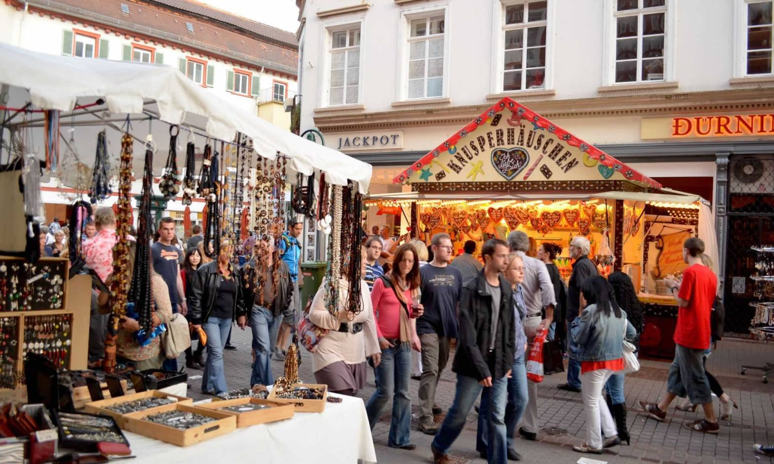 People walk the Hauptstrasse, Heidelberg's pedestrianized street, at the annual Herbstfest (Autumn Fest).