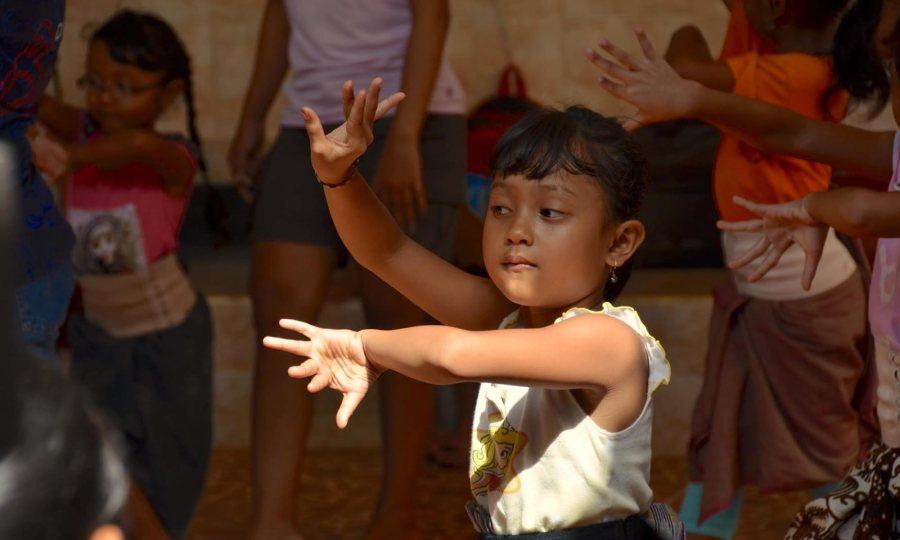 A child dances at a dance studio in Bali.