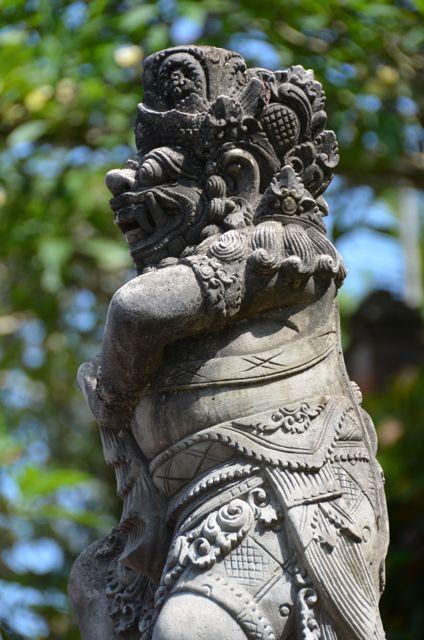 A grey Balinese statue.