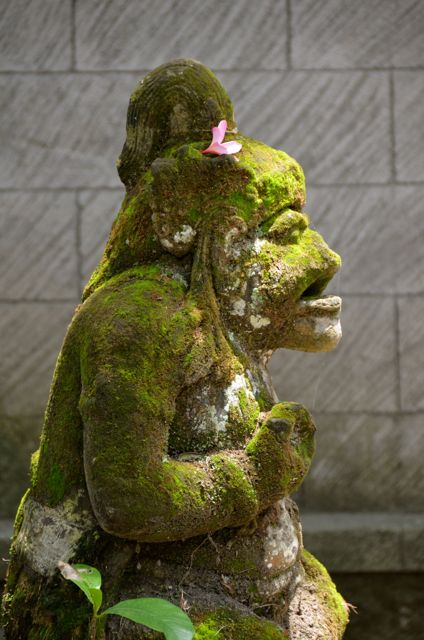 A moss-covered statue in Bali.