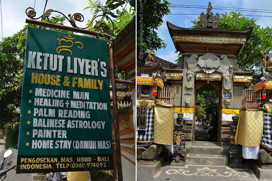 "The front of the Ketut Liyer home and a sign that reads: ""Ketut Liyer's house and family. Medicine man, healing and meditation, palm reading, Balinese astrology, painter, home stay (damuh mas). There is also an address and telephone number."