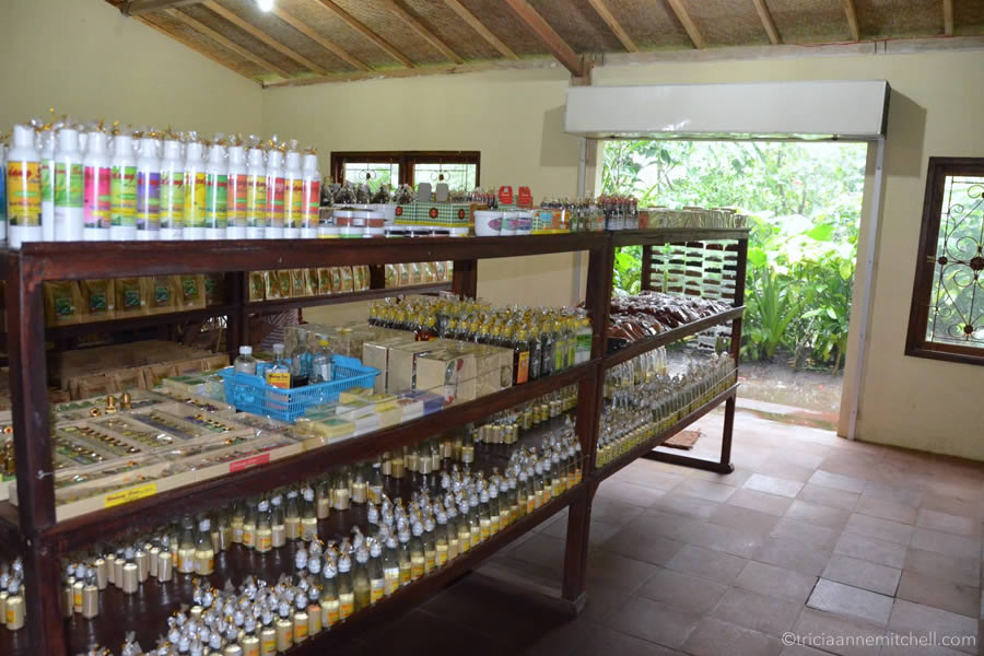 Shelves filled with bags of weasel coffee, cocoa powder and other Balinese spices at the Wedang Sari plantation.