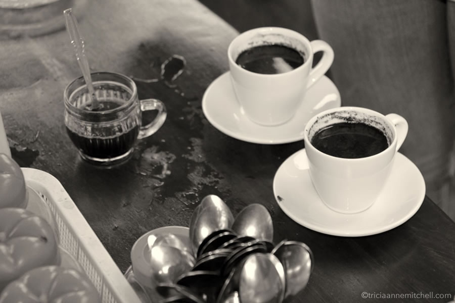Two cups of Kopi Luwak (nicknamed poop coffee ) sit on a counter in Bali, Indonesia.