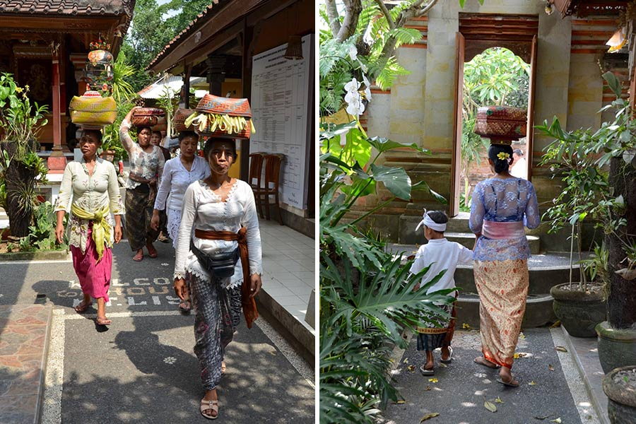 Women balance baskets containing spiritual offerings on top of their heads as they make their way into the inner courtyard of the Ketut Liyer home.