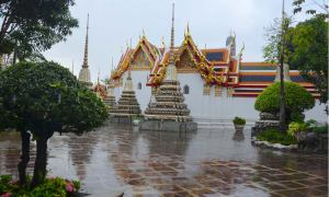 Puddles of rain collect in the courtyard of Bangkok's Wat Pho temple.