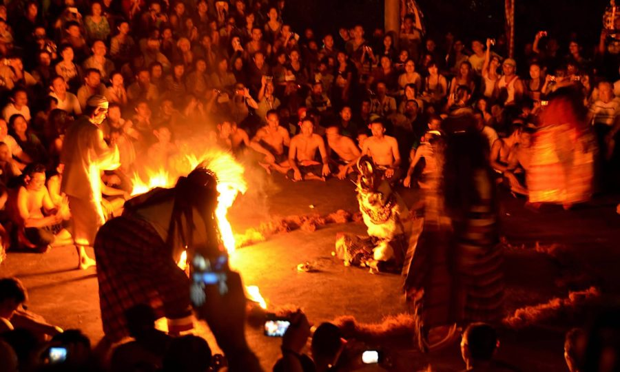 Spectators watch the kecak fire dance at Bali's Uluwatu Temple.