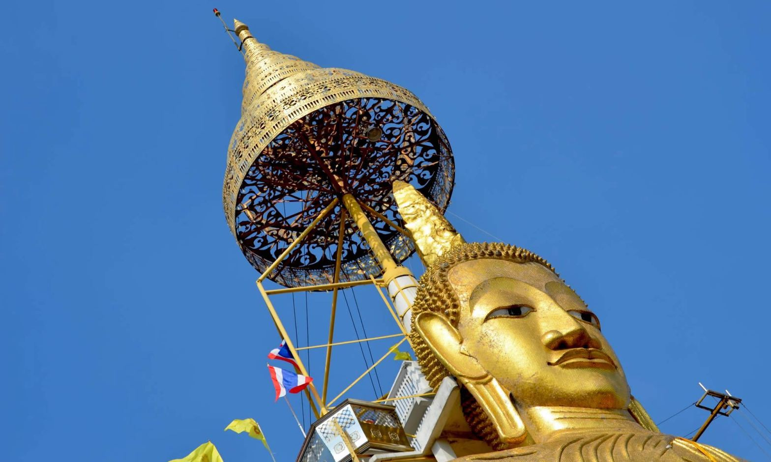Close up of the face of the Standing Buddha at Wat Intharawihan in Bangkok