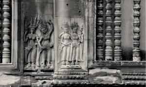 Two pairs of devatas (goddesses) are shown carved into Angkor Wat in Cambodia.
