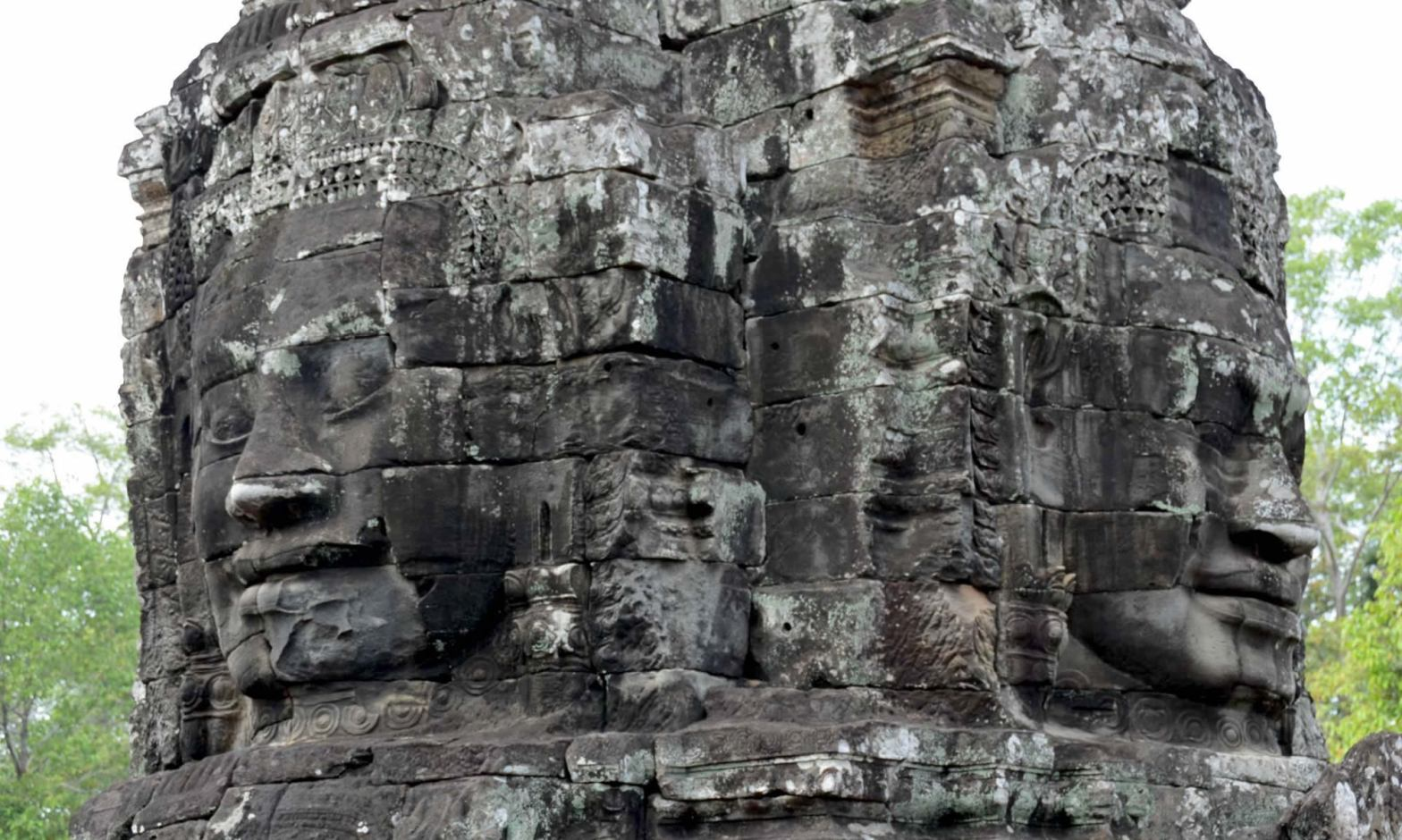 The remnants of two smiling faces adorn the Bayon Temple in Angkor Thom, Cambodia.