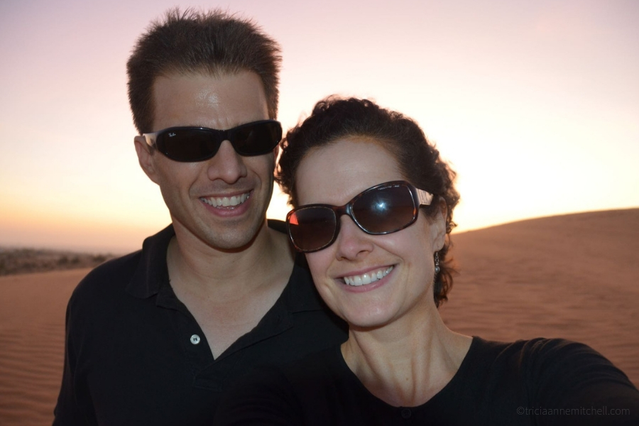 A couple poses at Mui Ne's Red Sand Dunes in Vietnam.