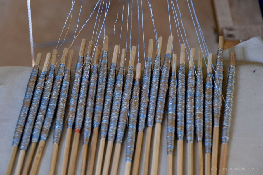 Cambodian Ikat silk weaving using blue and grey thread.