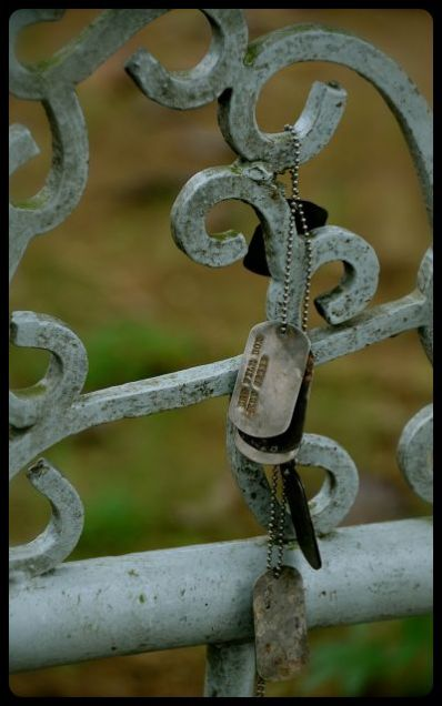 dog tags for sale, hanging on railing