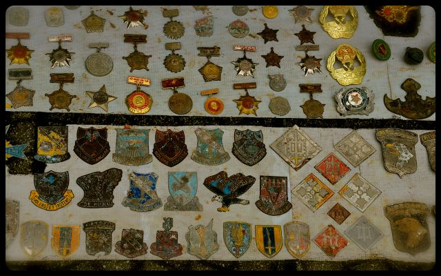 canteens, war medals and dog tags for sale on Vietnamese sidewalk