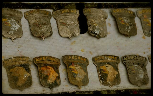 Airborne insignia / war medals and dog tags for sale on Vietnamese sidewalk