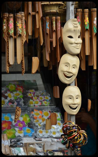 Masks and wind chimes for sale in an Ubud, Bali market.
