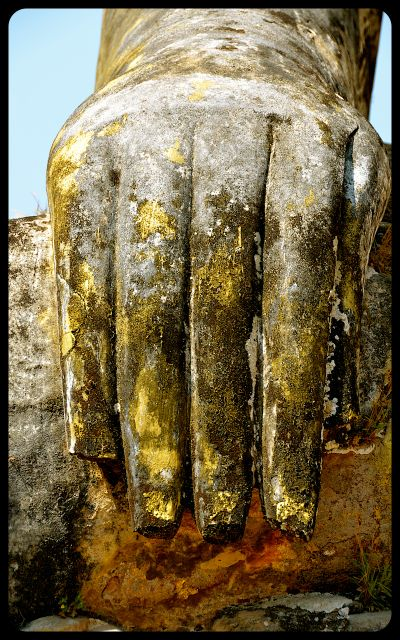 A close-up of the hand of the damaged Buddha statue at the Wat Phia Wat Temple in Laos.