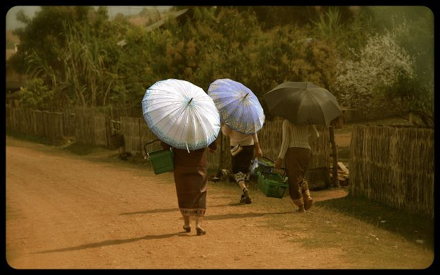 Ladies with umbrellas in Laos