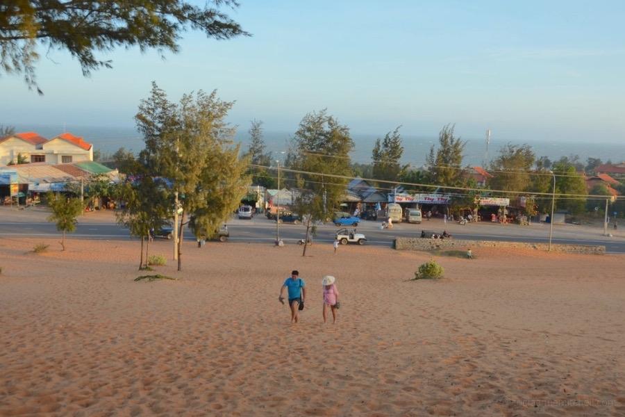 A couple walks on Mui Ne's Red Sand Dunes, in Vietnam.