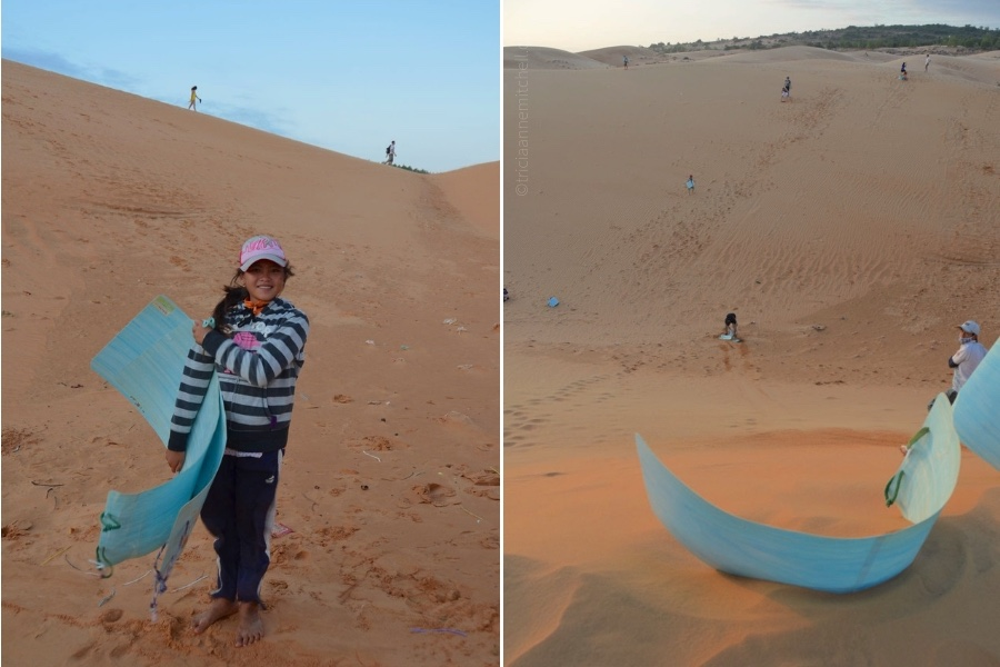 A girl holds a blue sheet of plastic, used for sand boarding in Mui Ne, Vietnam.