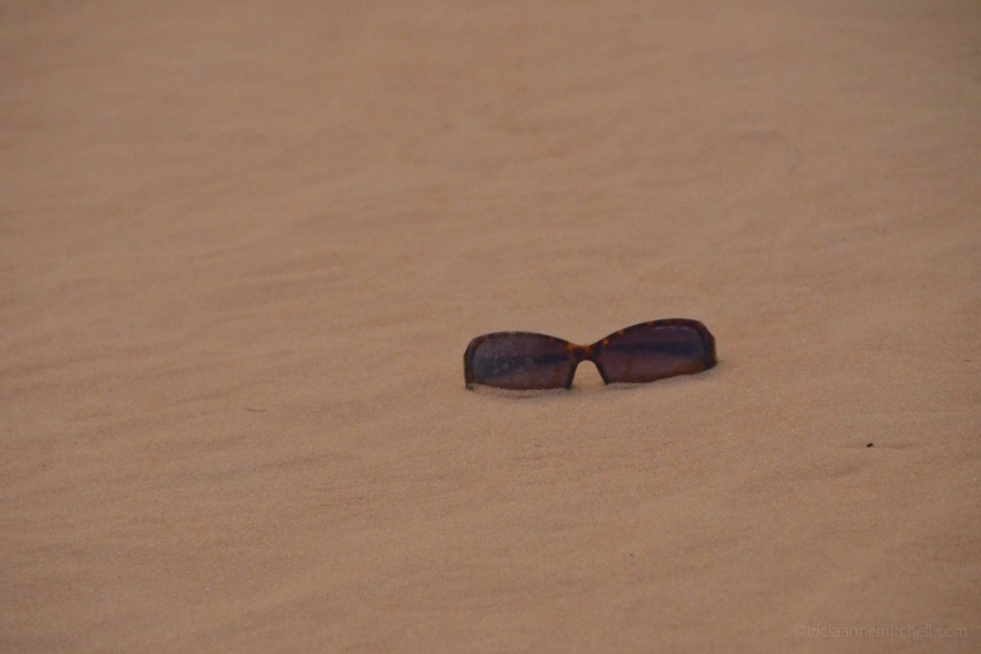 A pair of sunglasses at the Mui Ne Sand Dunes.