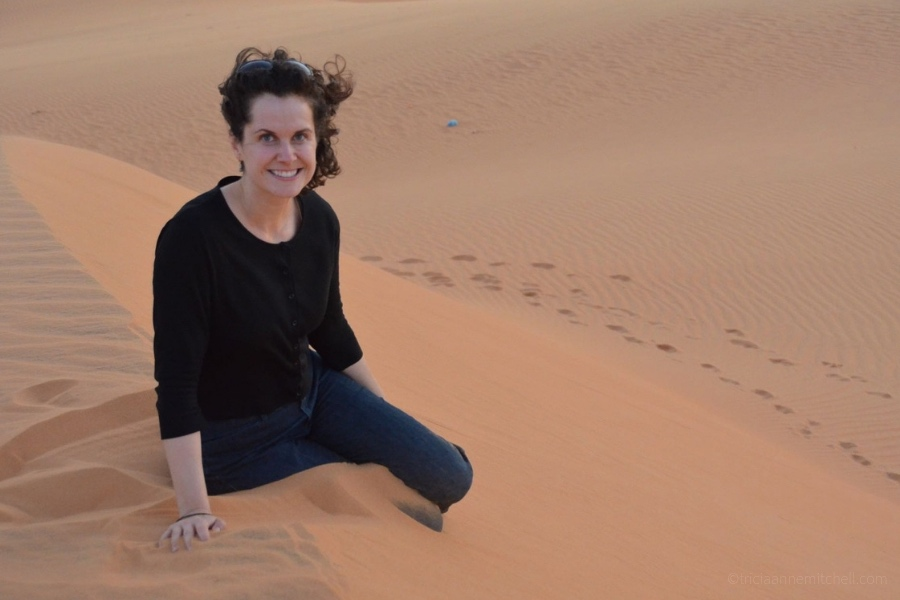 A woman sits on the Mui Ne Red Sand Dune in Vietnam.