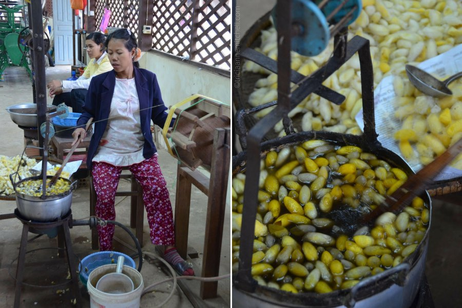 An employee stirs a pot of boiling water containing silkworm cocoons.
