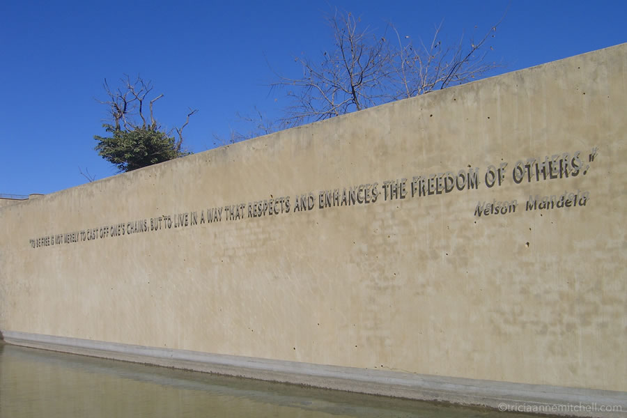 "An exterior wall of the Apartheid Museum in Johannesburg, South Africa. On it, Nelson Mandela's quote reads: ""For to be free is not merely to cast off one's chains, but to live in a way that respects and enhances the freedom of others."""