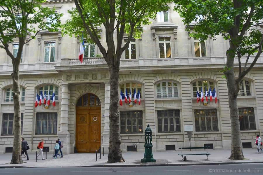 Paris French flags people walking sidewalk