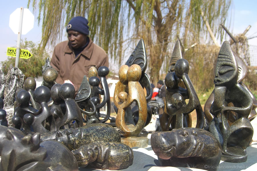 Soapstone art for sale on an outdoors table in Soweto, South Africa.