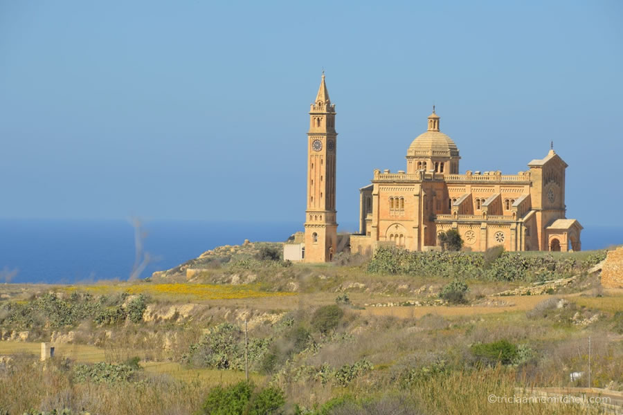 The Ta' Pinu Basilica towers over the landscape of the Maltese island of Gozo.
