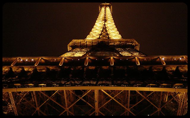 Eiffel Tower at night, looking up