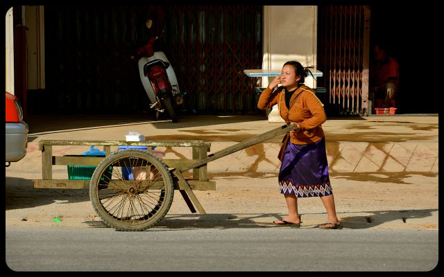 woman wearing traditional Laotian Sinh skirt in Vientiane, Laos