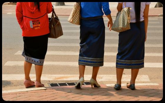 women wearing Laotian Sinh skirts in Vientiane, Laos