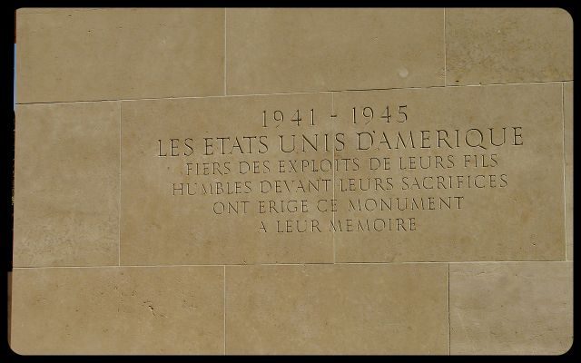 American Military Cemetery in Normandy French Inscription photograph by Tricia Mitchell