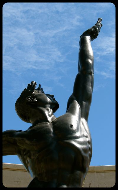 American Military Cemetery in Normandy Statue Reaching to Sky photograph by Tricia Mitchell