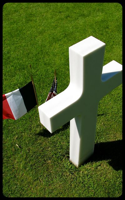 Grave in Normandy cemetery photograph by Tricia Mitchell