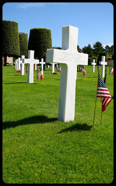 graves in Normandy cemetery photograph by Tricia Mitchell