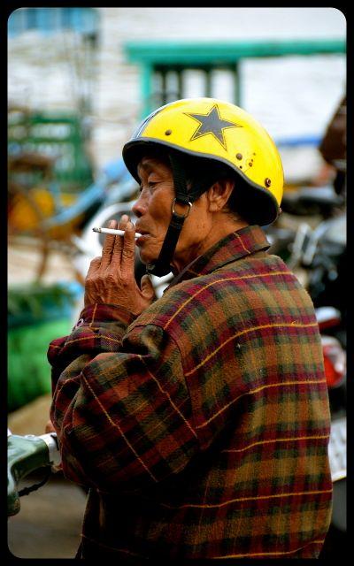 Man smoking in Hoi An Vietnam