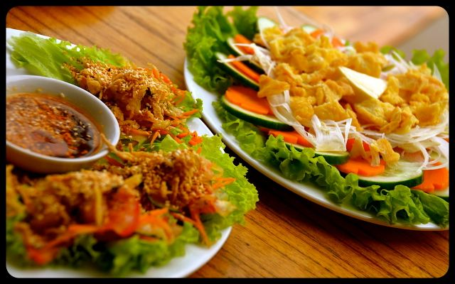Plates of Vietnamese food in Hoi An