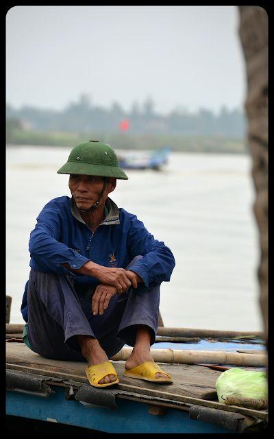 Man at riverside in Hoi An Vietnam