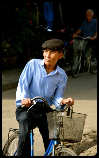 Man on bike in Hoi An Vietnam