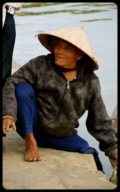 Woman near water in Hoi An, Vietnam