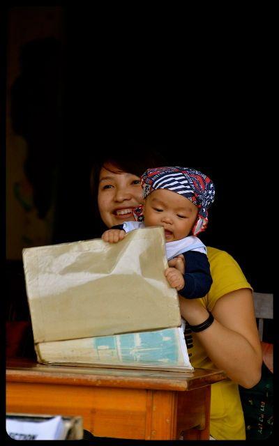 Baby mouthing menu in Hoi An Vietnam
