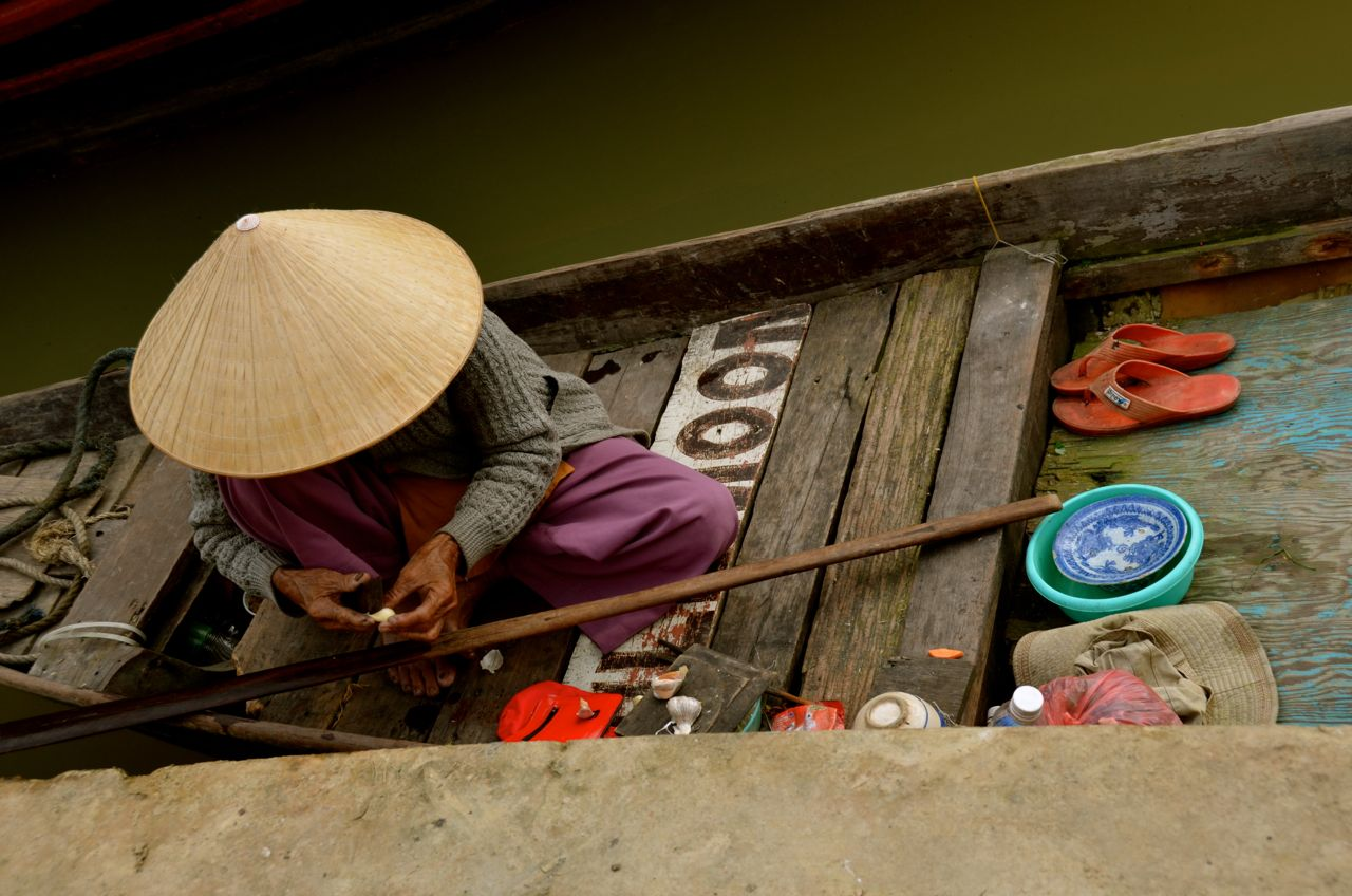at the thu bon river's edge in hoi an vietnam