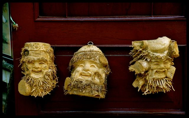 Faced carved out of wood in Hoi An Vietnam