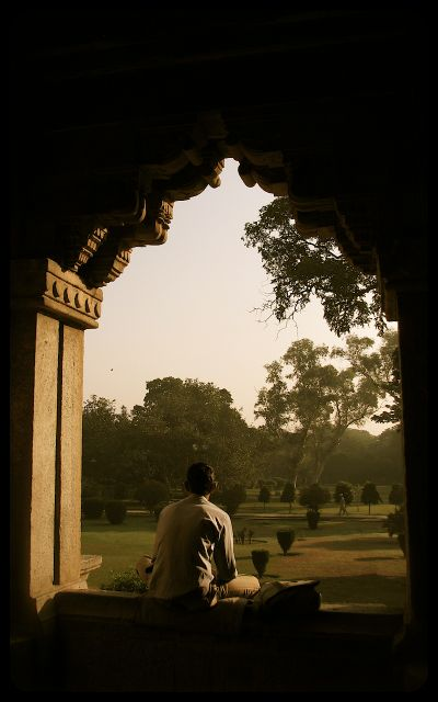 Man sitting in the Lodi Gardens - New Delhi, India